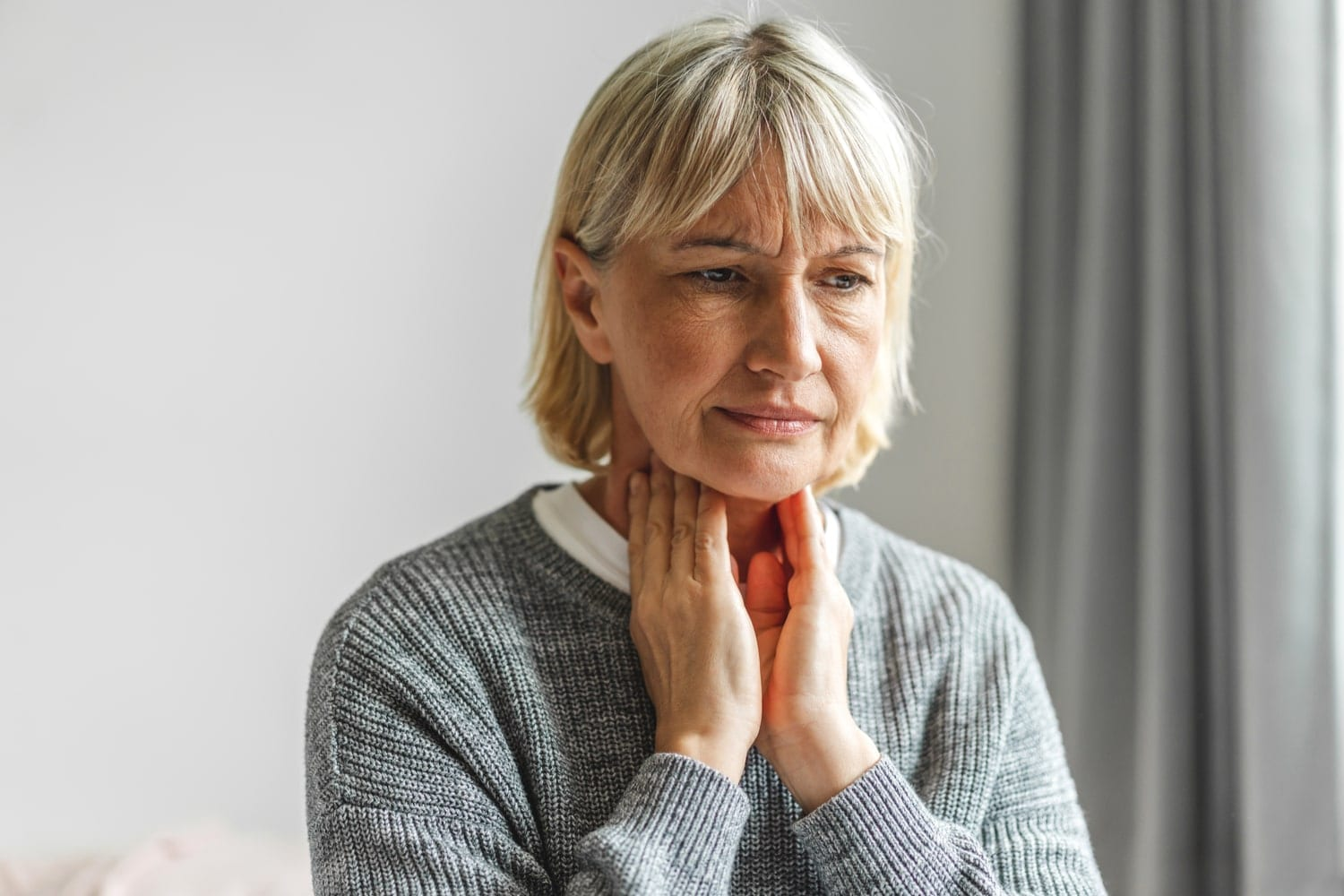 Senior Australian woman feeling ill with a pre-existing condition
