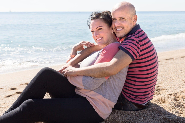 Australian couple sit on the beach