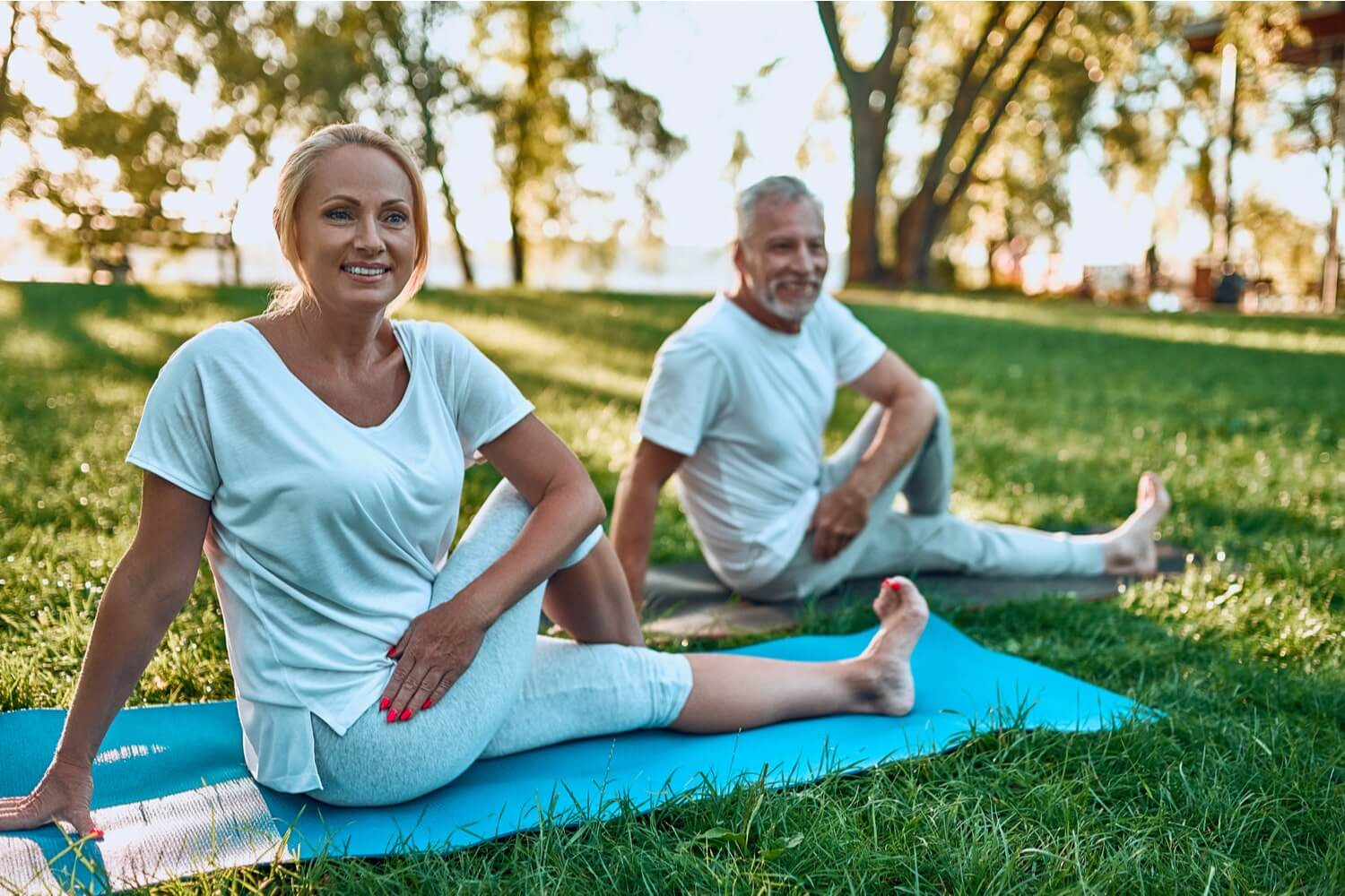 Over 50s couple stay fit and healthy by doing outdoor exercise