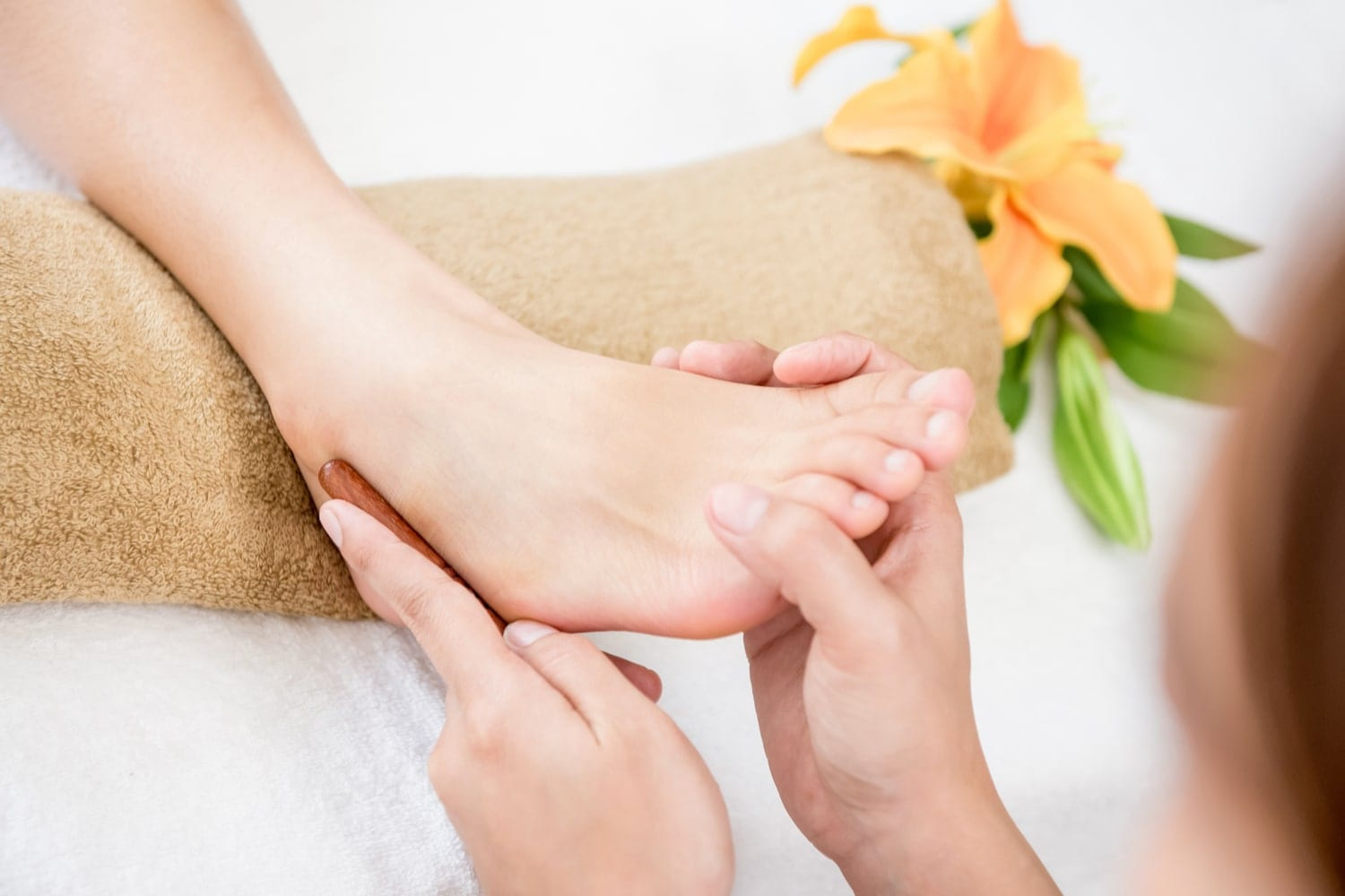 Woman receiving alternative therapy massage