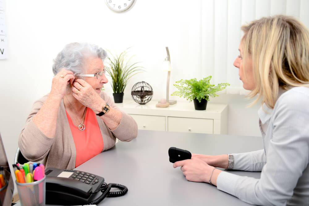 old woman hearing aid