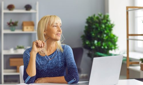Blonde middle age Australian woman thinks about life insurance