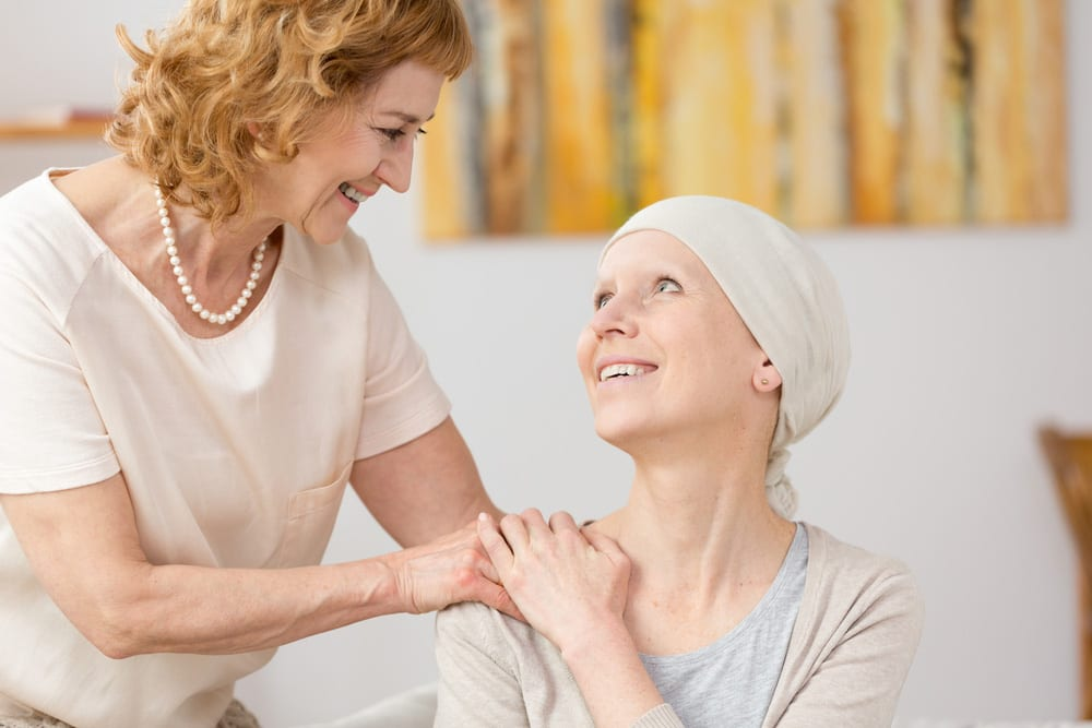 Woman supports her friend undergoing cancer treatment