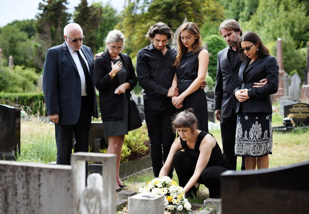 Family laying a tribute at a funeral